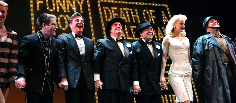 cast of the producers taking a bow on stage