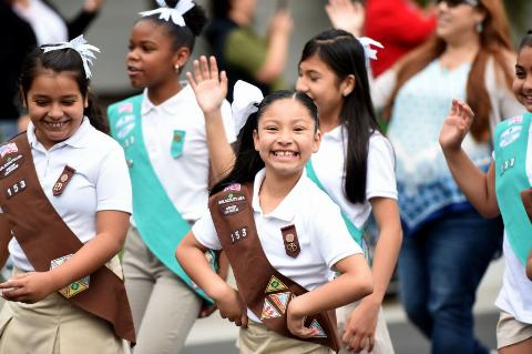 A proud girl scout flashes a smile.