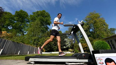 Former Southampton FC player and current club ambassador Francis Benali, runs the distance of a marathon on a treadmill