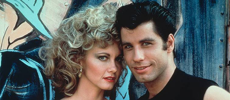 olivia newton-john and john travolta posing for a photo