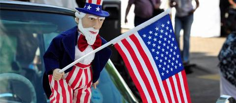 uncle sam holding the american flag
