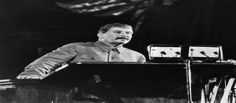 Joseph Stalin addresses voters at a podium.