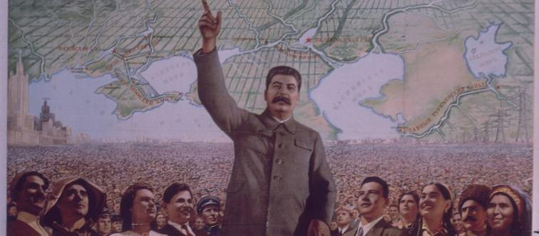 A poster of Joseph Stalin shows him with his hand raised.